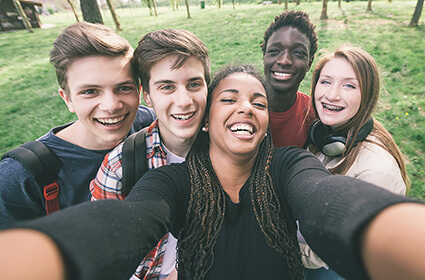 Happy teenagers transforming at a therapeutic facility for at-risk adolescents