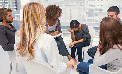 Elevations RTC - Troubled adolescents in group therapy