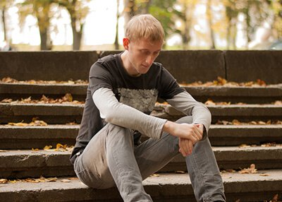 Elevations RTC - Sad male teenager fighting addiction and substance use