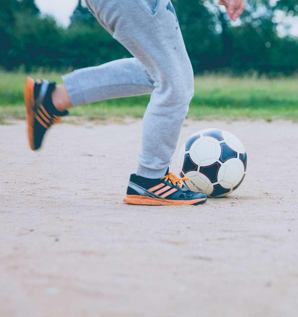A student enjoys outdoor recreation through soccer
